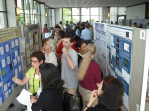 Crowded room full of attendees at the Poster Session at Spinal Cord Research Symposium 2009