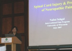 Speaker Nanlini Sehgal of the Interventional Pain Program presents a powerpoint slide on Spinal Cord Injury, June 2007