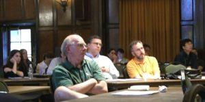 People watch a presentation attentatively