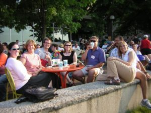 A large group of people enjoy the sunshine on the Terrace.