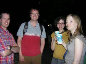 Four people pose for the camera