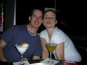 Two people pose with their drinks