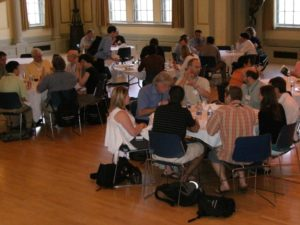 People gather around tables for lunch
