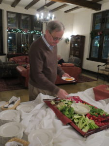 Getting snacks from the vegetable plate, Holiday Party, 2017