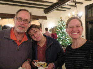 Three people pose for the camera, Holiday Party 2017