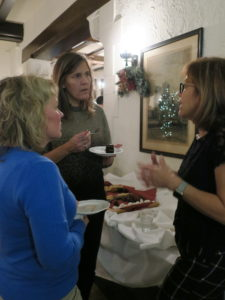 Sue Krey and Rebecca Welch chat at the Holiday Party 2017
