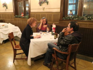 Party-goers sit around a table during the 2017 Holiday Party.