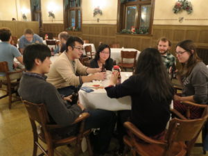 Party-goers sit around multiple tables during the 2017 Holiday Party.