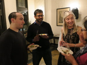 Ari Rosenberg, Baron Chanda, and Cindy Czajkowski chat with others at the Holiday Party, 2017.