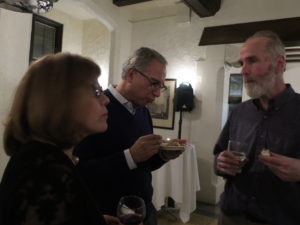 Meyer Jackson talks with other party-goers at the Holiday Party, 2017.